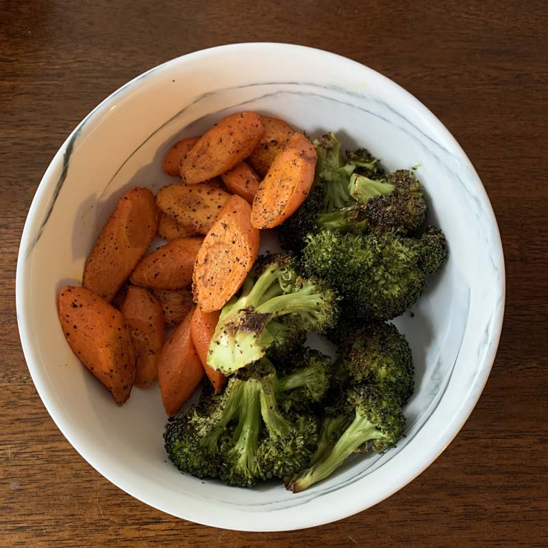 bowl of roasted carrots and broccoli